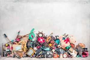 items piled up against a white wall for a garage sale