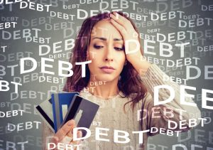 Concerned,Woman,Looking,At,Many,Credit,Cards,Scared,With,Huge
